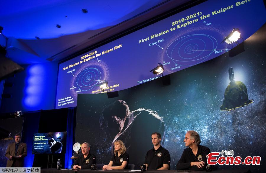 A new image of Ultima Thule, (Right) is displayed during a press conference after the New Horizons team received confirmation from the spacecraft has completed a flyby of Ultima Thule, Jan. 1, 2019, at the APL in Laurel, Maryland. The spacecraft survived the most distant exploration of another world, a tiny, icy object 4 billion miles away that looks to be shaped like a peanut or bowling pin. (Photo/Agencies)