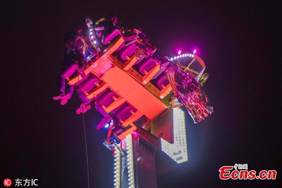 A fairground ride suspends in the air in Rennes, western France, Dec. 31, 2018. Three adults and five teenagers were trapped high in the air for more than eight hours from New Year's Eve into the early hours of 2019. (Photo/IC)