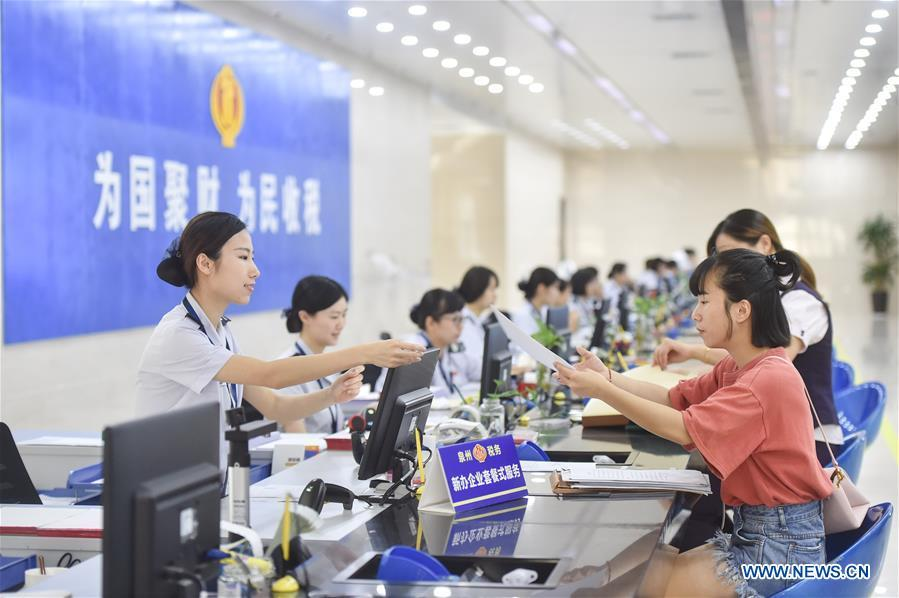 Staff members serve tax payers at the Fengze Street taxation hall of the Quanzhou tax bureau in Quanzhou City, southeast China\'s Fujian Province, Sept. 13, 2018. The 18th Central Committee of the Communist Party of China (CPC) held the third plenary session in November, 2013. In the five years since then, China\'s reform momentum had been particularly strong as the CPC decided to advance reform in all aspects during the meeting. Since the third plenary session, Chinese President Xi Jinping has presided over at least 45 high-profile meetings on advancing reforms, during which 400 documents and 1,932 reform plans have been launched. As a result, China\'s reform has been expanded from the economic field to a broad sphere including administrative management, culture, society, ecological conservation, Party building, and the military. (Xinhua/Song Weiwei)