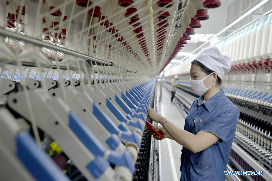 People work at a textile factory in the Xingtai economic development zone in Xingtai City, north China\'s Hebei Province, Dec. 20, 2018. The 18th Central Committee of the Communist Party of China (CPC) held the third plenary session in November, 2013. In the five years since then, China\'s reform momentum had been particularly strong as the CPC decided to advance reform in all aspects during the meeting. Since the third plenary session, Chinese President Xi Jinping has presided over at least 45 high-profile meetings on advancing reforms, during which 400 documents and 1,932 reform plans have been launched. As a result, China\'s reform has been expanded from the economic field to a broad sphere including administrative management, culture, society, ecological conservation, Party building, and the military. (Xinhua/Zhu Xudong)