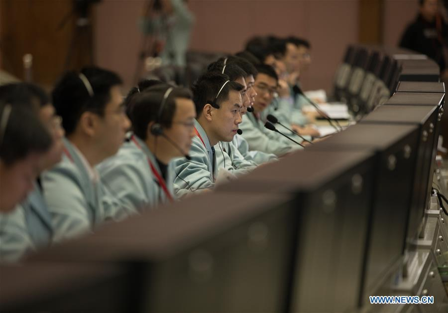 Technicians work at the Beijing Aerospace Control Center (BACC) in Beijing, capital of China, Jan. 3, 2019. China\'s Chang\'e-4 probe touched down on the far side of the moon Thursday, becoming the first spacecraft soft-landing on the moon\'s uncharted side never visible from Earth. The probe, comprising a lander and a rover, landed at the preselected landing area on the far side of the moon at 10:26 a.m. Beijing Time (0226 GMT), the China National Space Administration announced. (Xinhua/Jin Liwang)