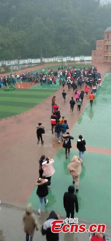 Students and teachers are evacuated to a safe area after a 5.3-magnitude earthquake jolted Gongxian County, Yibin City in Southwest China\'s Sichuan Province at 8:48 a.m., Jan. 3, 2019. No casualties have been reported but some houses were damaged, Xinhua reported.  (Photo: China News Service/Chang Ting)