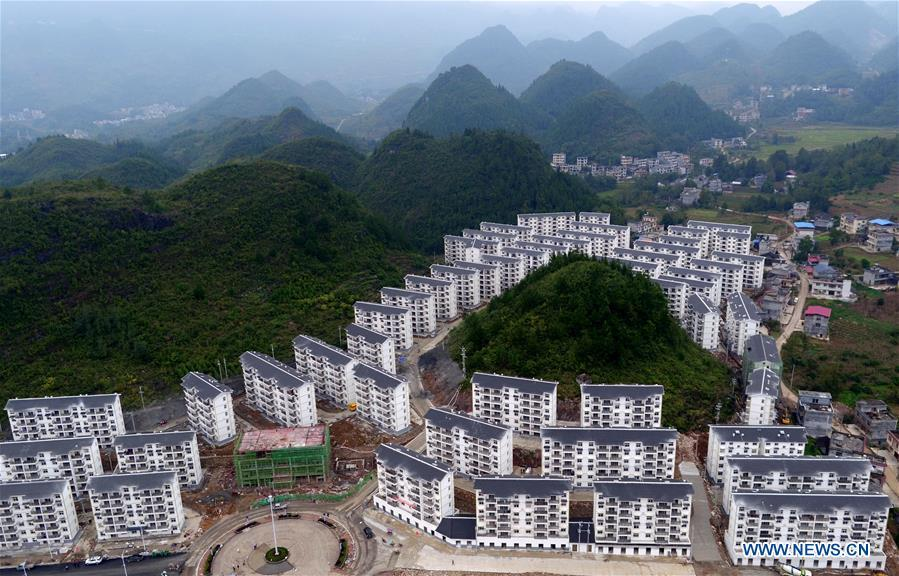 Aerial photo taken on Oct. 15, 2018 shows a view of the Songping settlement for poverty relief relocation in Shadaogou Town of Xuan\'en County, central China\'s Hubei Province. The 18th Central Committee of the Communist Party of China (CPC) held the third plenary session in November, 2013. In the five years since then, China\'s reform momentum had been particularly strong as the CPC decided to advance reform in all aspects during the meeting. Since the third plenary session, Chinese President Xi Jinping has presided over at least 45 high-profile meetings on advancing reforms, during which 400 documents and 1,932 reform plans have been launched. As a result, China\'s reform has been expanded from the economic field to a broad sphere including administrative management, culture, society, ecological conservation, Party building, and the military. (Xinhua/Song Wen)
