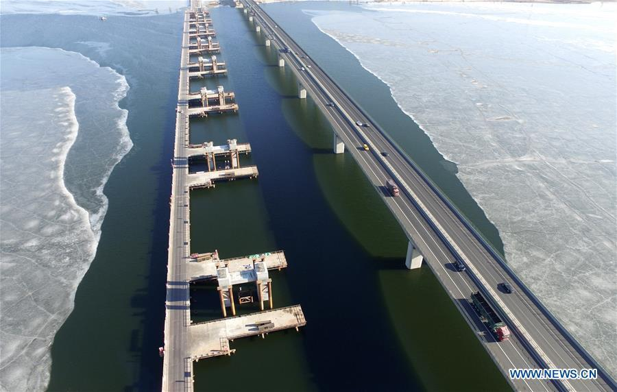 Aerial photo taken on Feb. 14, 2017 shows the under-construction bridge of the Jingzhang High-speed Railway across the Guanting Reservoir in Huailai County of Zhangjiakou City, north China\'s Hebei Province. The 18th Central Committee of the Communist Party of China (CPC) held the third plenary session in November, 2013. In the five years since then, China\'s reform momentum had been particularly strong as the CPC decided to advance reform in all aspects during the meeting. Since the third plenary session, Chinese President Xi Jinping has presided over at least 45 high-profile meetings on advancing reforms, during which 400 documents and 1,932 reform plans have been launched. As a result, China\'s reform has been expanded from the economic field to a broad sphere including administrative management, culture, society, ecological conservation, Party building, and the military. (Xinhua/Wu Diansen)
