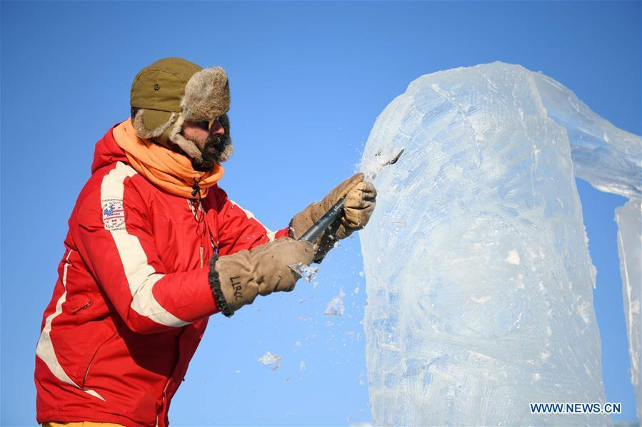 A contestant carves an ice sculpture during an international ice sculpture competition in Harbin, capital of northeast China\'s Heilongjiang Province, Jan. 2, 2019. A total of 16 teams from 12 countries and regions took part in the competition. (Xinhua/Wang Jianwei)