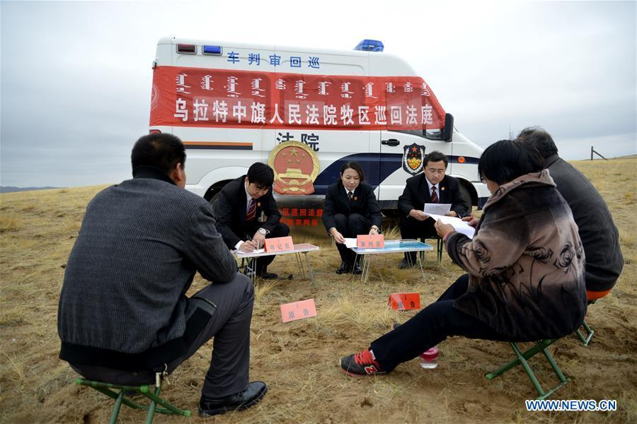 The circuit court for the pastoral areas of Urad Middle Banner mediates a civil dispute in Urad Middle Banner, north China\'s Inner Mongolia Autonomous Region, Oct. 30, 2014. The 18th Central Committee of the Communist Party of China (CPC) held the third plenary session in November, 2013. In the five years since then, China\'s reform momentum had been particularly strong as the CPC decided to advance reform in all aspects during the meeting. Since the third plenary session, Chinese President Xi Jinping has presided over at least 45 high-profile meetings on advancing reforms, during which 400 documents and 1,932 reform plans have been launched. As a result, China\'s reform has been expanded from the economic field to a broad sphere including administrative management, culture, society, ecological conservation, Party building, and the military. (Xinhua/Zhi Maosheng)