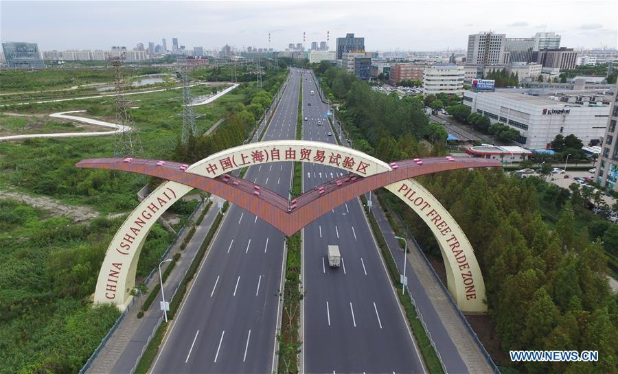 Aerial photo taken on Sept. 21, 2016 shows a view of the China (Shanghai) Pilot Free Trade Zone in Shanghai, east China. The 18th Central Committee of the Communist Party of China (CPC) held the third plenary session in November, 2013. In the five years since then, China\'s reform momentum had been particularly strong as the CPC decided to advance reform in all aspects during the meeting. Since the third plenary session, Chinese President Xi Jinping has presided over at least 45 high-profile meetings on advancing reforms, during which 400 documents and 1,932 reform plans have been launched. As a result, China\'s reform has been expanded from the economic field to a broad sphere including administrative management, culture, society, ecological conservation, Party building, and the military. (Xinhua/Pei Xin)