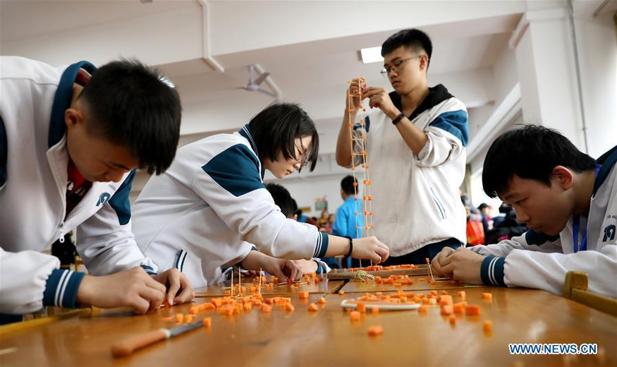 Students compete in a science and technology game at No. 4 Middle School in Shijiazhuang, capital of north China\'s Hebei Province, Dec. 26, 2018. China\'s primary and middle schools have been urged to improve education for all-around student development, according to a directive issued by authorities. Jointly issued by the Ministry of Education and other eight agencies, the circular asked schools to offer courses that are in accord with the national syllabus in terms of their quantity and quality. The enhancement of courses\' difficulty levels and speed at random and in disregard of the curriculum is prohibited, according to the circular. Primary and junior middle schools are not allowed to set up any \