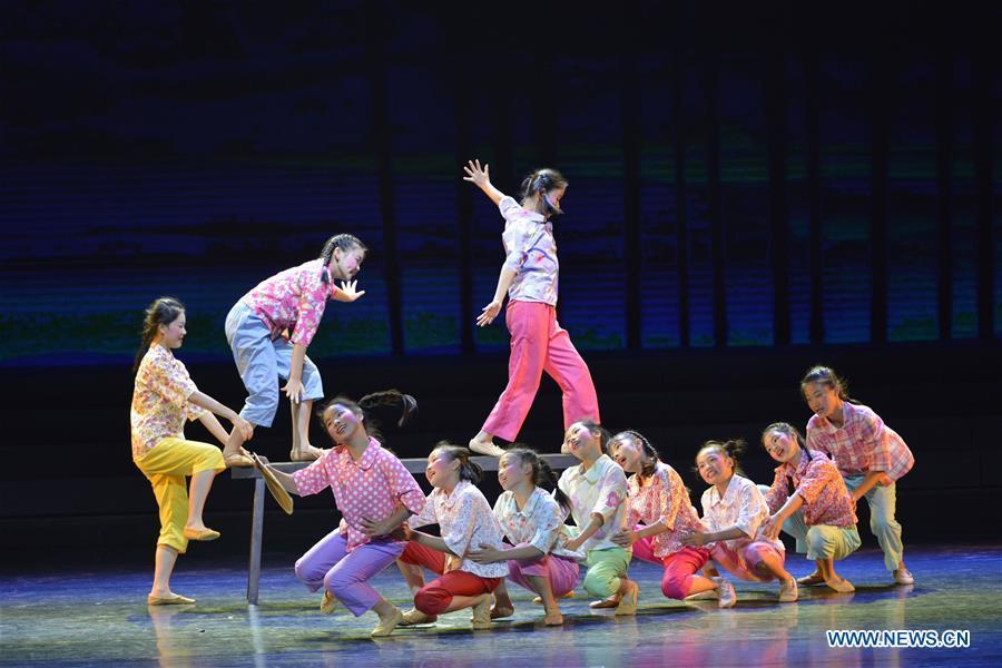 Students dance at No. 2 Experimental Primary School in Lianjiang County, southeast China\'s Fujian Province, Oct. 28, 2018. China\'s primary and middle schools have been urged to improve education for all-around student development, according to a directive issued by authorities. Jointly issued by the Ministry of Education and other eight agencies, the circular asked schools to offer courses that are in accord with the national syllabus in terms of their quantity and quality. The enhancement of courses\' difficulty levels and speed at random and in disregard of the curriculum is prohibited, according to the circular. Primary and junior middle schools are not allowed to set up any \