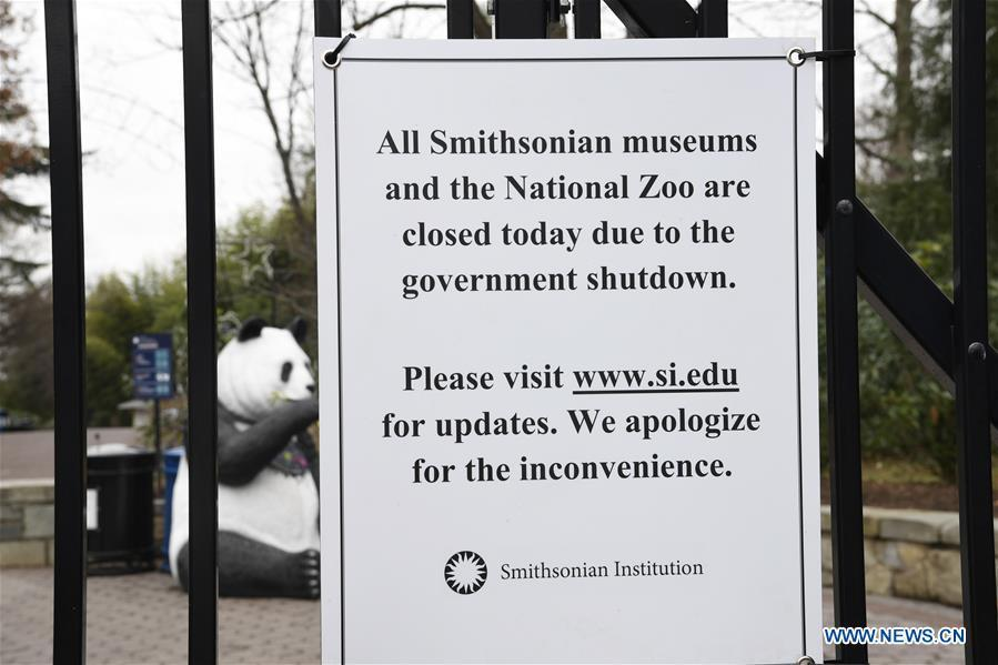 Photo taken on Jan. 2, 2019 shows a notice of closure on the gate of the National Zoo in Washington D.C., the United States. The 19 Smithsonian museums and the National Zoo in Washington D.C. closed their doors on Wednesday as the partial U.S. government shutdown dragged on. (Xinhua/Liu Jie)