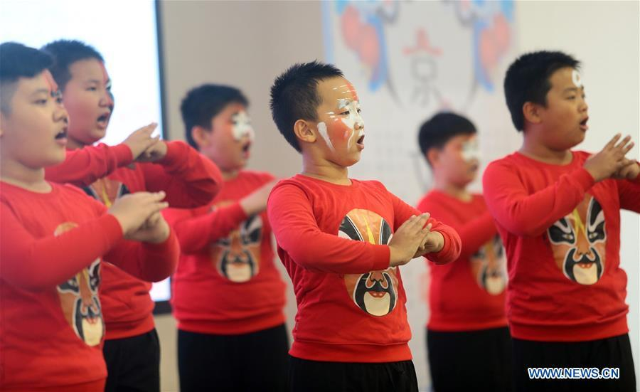 Pupils perform Beijing Opera at a primary school in Tianjin, north China, Sept. 26, 2018. China\'s primary and middle schools have been urged to improve education for all-around student development, according to a directive issued by authorities. Jointly issued by the Ministry of Education and other eight agencies, the circular asked schools to offer courses that are in accord with the national syllabus in terms of their quantity and quality. The enhancement of courses\' difficulty levels and speed at random and in disregard of the curriculum is prohibited, according to the circular. Primary and junior middle schools are not allowed to set up any \