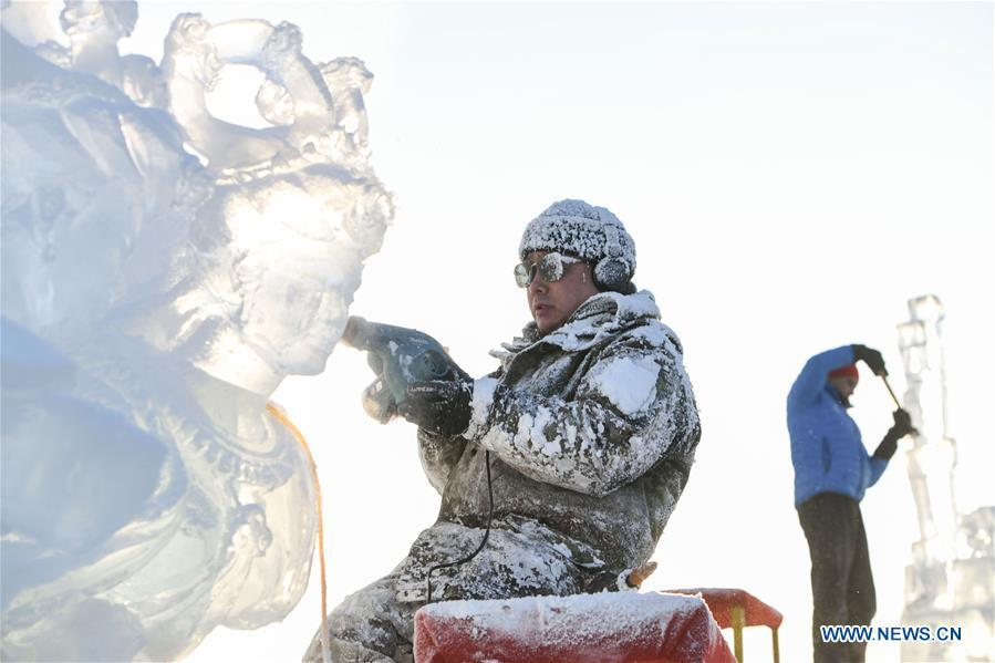 Contestants carve ice sculptures during an international ice sculpture competition in Harbin, capital of northeast China\'s Heilongjiang Province, Jan. 2, 2019. A total of 16 teams from 12 countries and regions took part in the competition. (Xinhua/Wang Song)