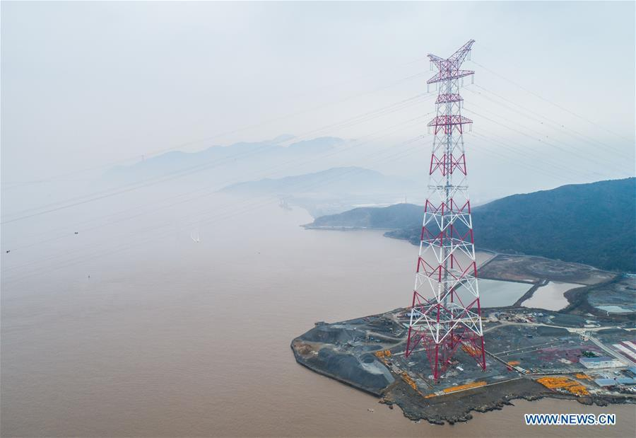 Aerial photo taken on Jan. 3, 2019 shows one of the giant power supply pylons in Zhoushan, east China\'s Zhejiang Province. The two 380-meter-tall pylons carry power cables between Zhoushan\'s Jintang and Cezi islands, a distance of 2,656 meters. The new pylon project is a part of a new ultra-high voltage power line project between cities of Zhoushan and Ningbo. (Xinhua/Xu Yu)
