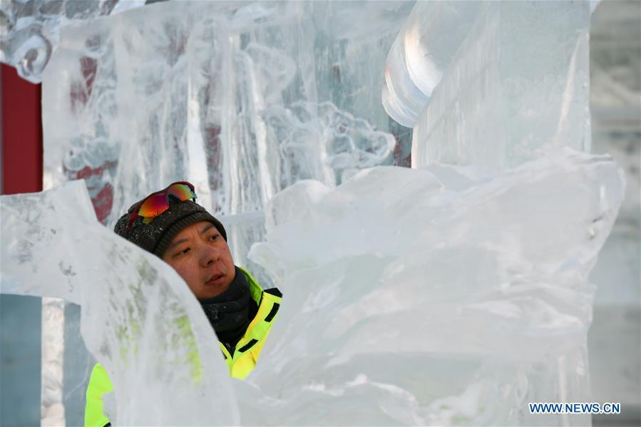 A contestant carves an ice sculpture during an international ice sculpture competition in Harbin, capital of northeast China\'s Heilongjiang Province, Jan. 3, 2019. (Xinhua/Wang Song)