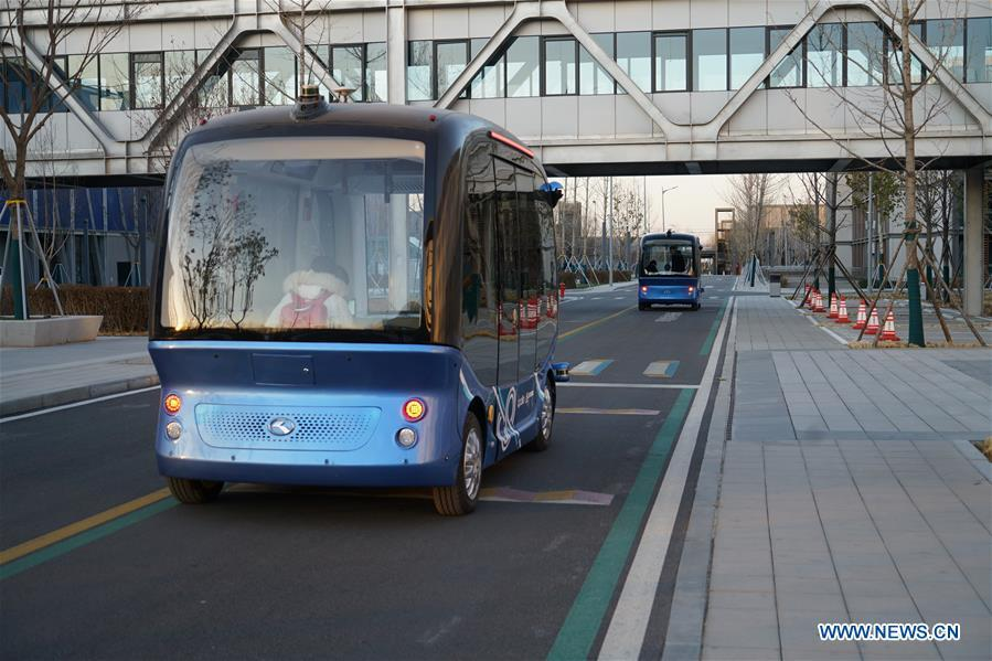 Self-driving cars run at the Xiongan public services center in Xiongan New Area, north China\'s Hebei Province, Dec. 7, 2018. China\'s central authorities have approved the 2018-2035 master plan for Xiongan New Area, stressing that its creation is significant to high-quality development and the building of the modern economic system. The plan was approved by the Central Committee of the Communist Party of China (CPC) and the State Council. The master plan is the fundamental guideline for the development, construction and management of the Xiongan New Area and should be strictly implemented, according to the approval released on Wednesday. The plan also lists overall development goals for the new area. By 2035, Xiongan will basically develop into a modern city that is green, intelligent and livable, with relatively strong competitiveness and harmonious human-environment interaction. (Xinhua/Mu Yu)