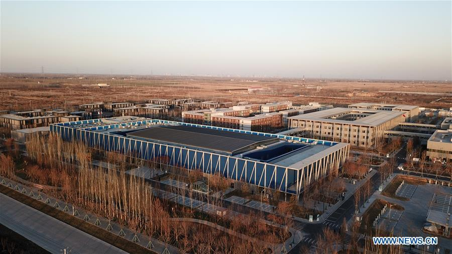 Aerial photo taken on Dec. 7, 2018 shows the Xiongan public services center in Xiongan New Area, north China\'s Hebei Province. China\'s central authorities have approved the 2018-2035 master plan for Xiongan New Area, stressing that its creation is significant to high-quality development and the building of the modern economic system. The plan was approved by the Central Committee of the Communist Party of China (CPC) and the State Council. The master plan is the fundamental guideline for the development, construction and management of the Xiongan New Area and should be strictly implemented, according to the approval released on Wednesday. The plan also lists overall development goals for the new area. By 2035, Xiongan will basically develop into a modern city that is green, intelligent and livable, with relatively strong competitiveness and harmonious human-environment interaction. (Xinhua/Yang Shiyao)