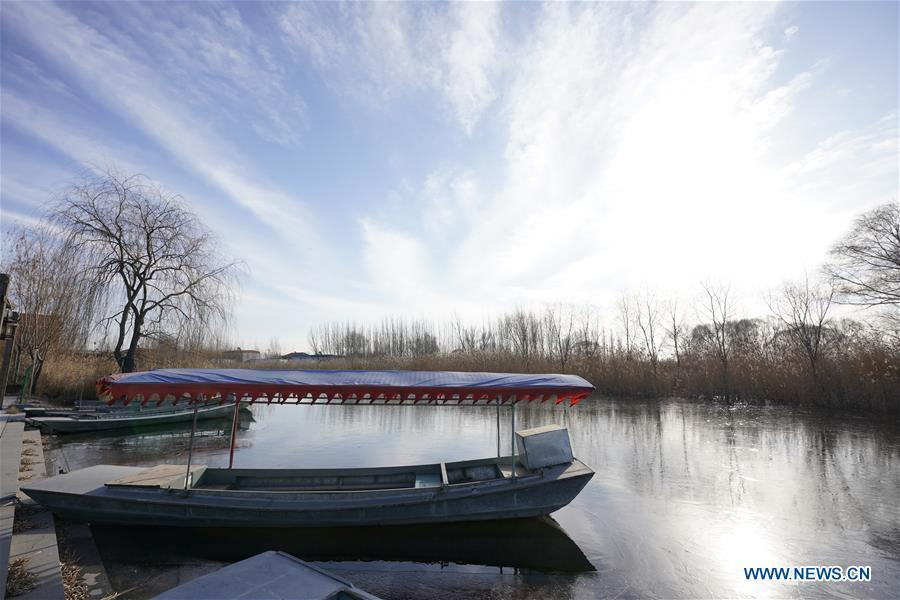 A boat is moored on the Baiyangdian lake in Xiongan New Area, north China\'s Hebei Province, Dec. 7, 2018. China\'s central authorities have approved the 2018-2035 master plan for Xiongan New Area, stressing that its creation is significant to high-quality development and the building of the modern economic system. The plan was approved by the Central Committee of the Communist Party of China (CPC) and the State Council. The master plan is the fundamental guideline for the development, construction and management of the Xiongan New Area and should be strictly implemented, according to the approval released on Wednesday. The plan also lists overall development goals for the new area. By 2035, Xiongan will basically develop into a modern city that is green, intelligent and livable, with relatively strong competitiveness and harmonious human-environment interaction. (Xinhua/Xing Guangli)