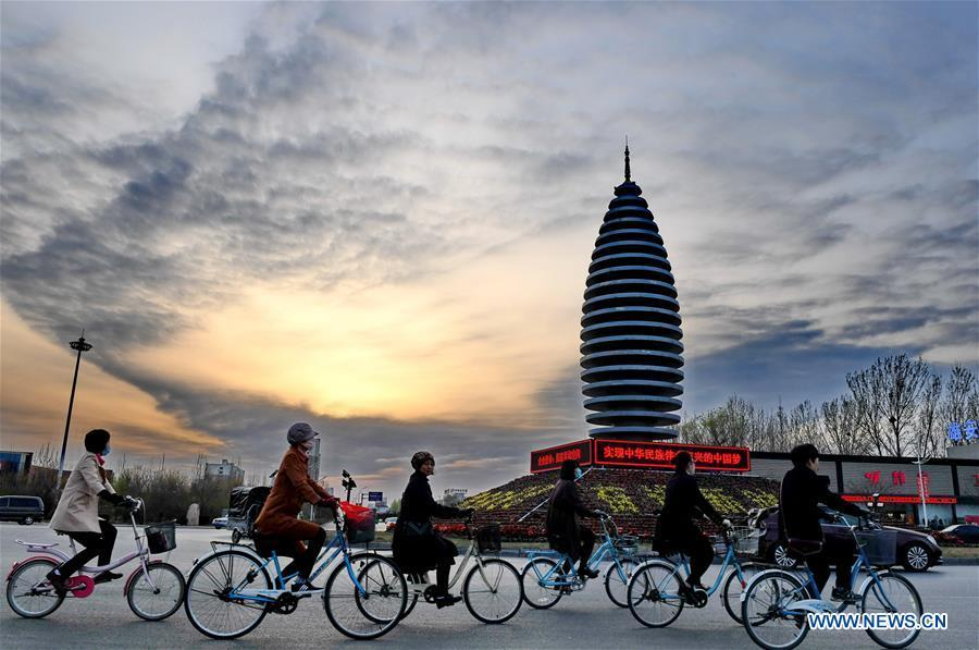 Citizens ride in Rongcheng County of Xiongan New Area, north China\'s Hebei Province, March 29, 2018. China\'s central authorities have approved the 2018-2035 master plan for Xiongan New Area, stressing that its creation is significant to high-quality development and the building of the modern economic system. The plan was approved by the Central Committee of the Communist Party of China (CPC) and the State Council. The master plan is the fundamental guideline for the development, construction and management of the Xiongan New Area and should be strictly implemented, according to the approval released on Wednesday. The plan also lists overall development goals for the new area. By 2035, Xiongan will basically develop into a modern city that is green, intelligent and livable, with relatively strong competitiveness and harmonious human-environment interaction. (Xinhua/Mu Yu)