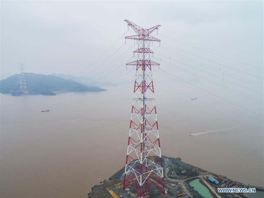 Aerial photo taken on Jan. 3, 2019 shows the giant power supply pylons in Zhoushan, east China\'s Zhejiang Province. The two 380-meter-tall pylons carry power cables between Zhoushan\'s Jintang and Cezi islands, a distance of 2,656 meters. The new pylon project is a part of a new ultra-high voltage power line project between cities of Zhoushan and Ningbo. (Xinhua/Xu Yu)