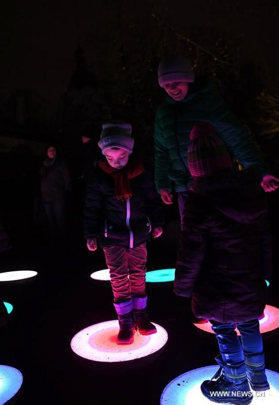 Children step on illuminated installations during China Light Festival at Cologne Zoo in Cologne, Germany, on Jan. 3, 2019. The festival is held here presenting more than 50 lights from Dec. 8, 2018 to Jan. 20, 2019. (Xinhua/Lu Yang)