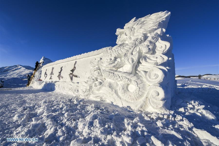 People create a snow sculpture for Hom scenic area in Kanas, northwest China\'s Xinjiang Uygur Autonomous Region, Jan. 2, 2019. Kanas scenic spot attracts lots of visitors in winter with its pure snow scenery and various entertainment. (Xinhua/Hu Huhu)