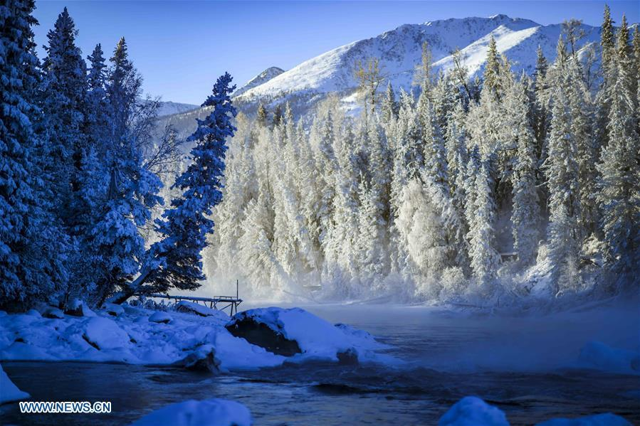Photo taken on Jan. 2, 2019 shows scenery near the Kanas Lake in Kanas, northwest China\'s Xinjiang Uygur Autonomous Region. Kanas scenic spot attracts lots of visitors in winter with its pure snow scenery and various entertainment. (Xinhua/Zhao Ge)