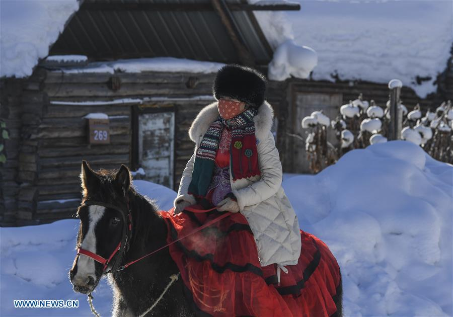 A visitor rides a horse in Kanas, northwest China\'s Xinjiang Uygur Autonomous Region, Jan. 2, 2019. Kanas scenic spot attracts lots of visitors in winter with its pure snow scenery and various entertainment. (Xinhua/Hu Huhu)