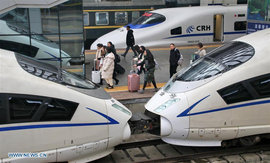 <?php echo strip_tags(addslashes(Passengers take a train at the Yantai Railway Station in Yantai, east China's Shandong Province, Jan. 4, 2019. China will put into use the new train diagram starting from Jan. 5.(Xinhua/Tang Ke))) ?>