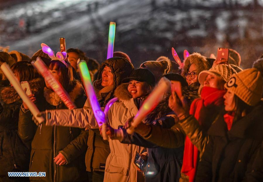 Photo taken on Dec. 31, 2018 shows visitors celebrating the New Year during a bonfire party in Hom scenic area of Kanas, northwest China\'s Xinjiang Uygur Autonomous Region. Kanas scenic spot attracts lots of visitors in winter with its pure snow scenery and various entertainment. (Xinhua/Zhao Ge)