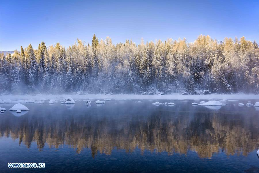 Photo taken on Jan. 2, 2019 shows cedar trees near the Kanas Lake in Kanas, northwest China\'s Xinjiang Uygur Autonomous Region. Kanas scenic spot attracts lots of visitors in winter with its pure snow scenery and various entertainment. (Xinhua/Zhao Ge)
