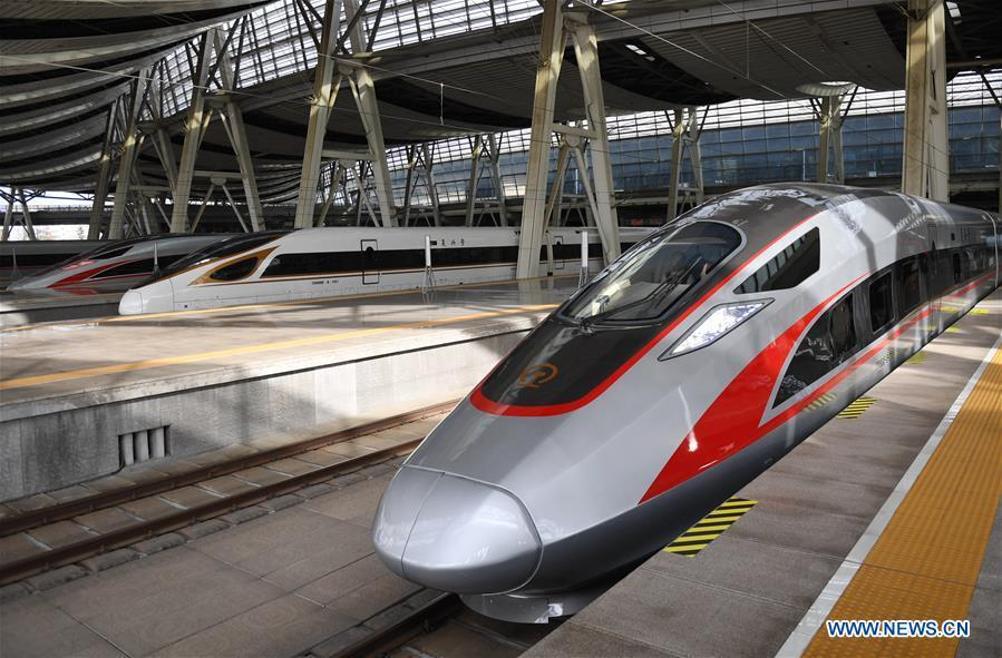 Photo taken on Jan. 5, 2019 shows a new Fuxing bullet train (R) at Beijing South Railway Station in Beijing, capital of China. A longer Fuxing bullet train started running on the Beijing-Shanghai line Saturday at noon. The new train, with a designed speed of 350 km per hour, has 17 carriages, one carriage longer than the Fuxing trains currently in use. (Xinhua/Zhang Chenlin)