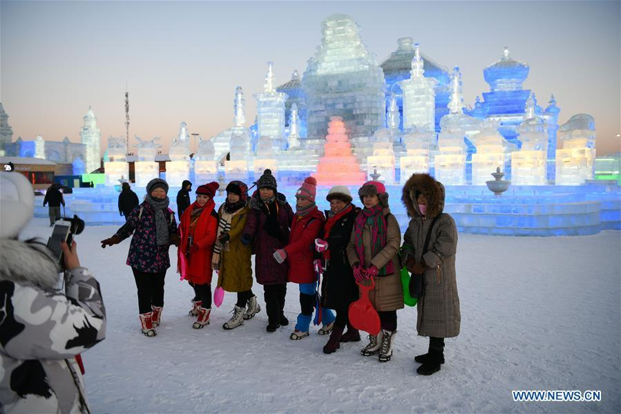 Tourists pose for a group photo at the Ice-Snow World in Harbin, capital of northeast China\'s Heilongjiang Province, Jan. 5, 2019. The 35th Harbin International Ice and Snow Festival kicked off here on Saturday. (Xinhua/Wang Song)