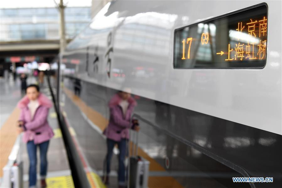 Passengers board on a new Fuxing bullet train at Beijing South Railway Station in Beijing, capital of China, Jan. 5, 2019. A longer Fuxing bullet train started running on the Beijing-Shanghai line Saturday at noon. The new train, with a designed speed of 350 km per hour, has 17 carriages, one carriage longer than the Fuxing trains currently in use. (Xinhua/Zhang Chenlin)
