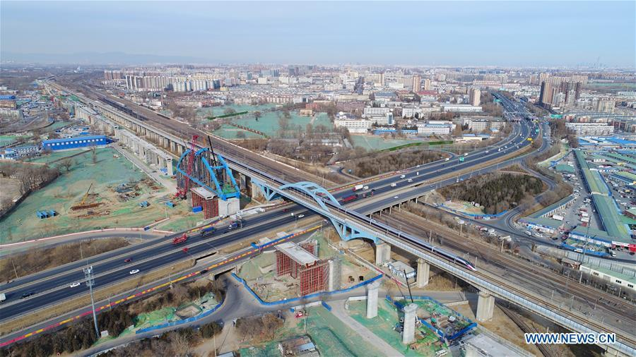 Photo taken on Jan. 5, 2019 shows a new Fuxing bullet train running past Huangcun bridge in Beijing, capital of China. A longer Fuxing bullet train started running on the Beijing-Shanghai line Saturday at noon. The new train, with a designed speed of 350 km per hour, has 17 carriages, one carriage longer than the Fuxing trains currently in use. (Xinhua/Xing Guangli)
