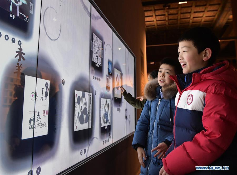 Visitors view Han Meilin\'s Chinese Zodiac Art Exhibition in Beijing, capital of China, Jan. 5, 2019. The Chinese Zodiac Art Exhibition, displaying the fine arts of Chinese artist Han Meilin, kicked off in the Palace Museum on Saturday and will last until Feb. 20, 2019. (Xinhua/Li He)