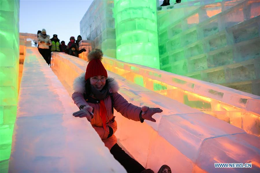 Tourists try ice slide at the Ice-Snow World in Harbin, capital of northeast China\'s Heilongjiang Province, Jan. 5, 2019. The 35th Harbin International Ice and Snow Festival kicked off here on Saturday. (Xinhua/Wang Song)