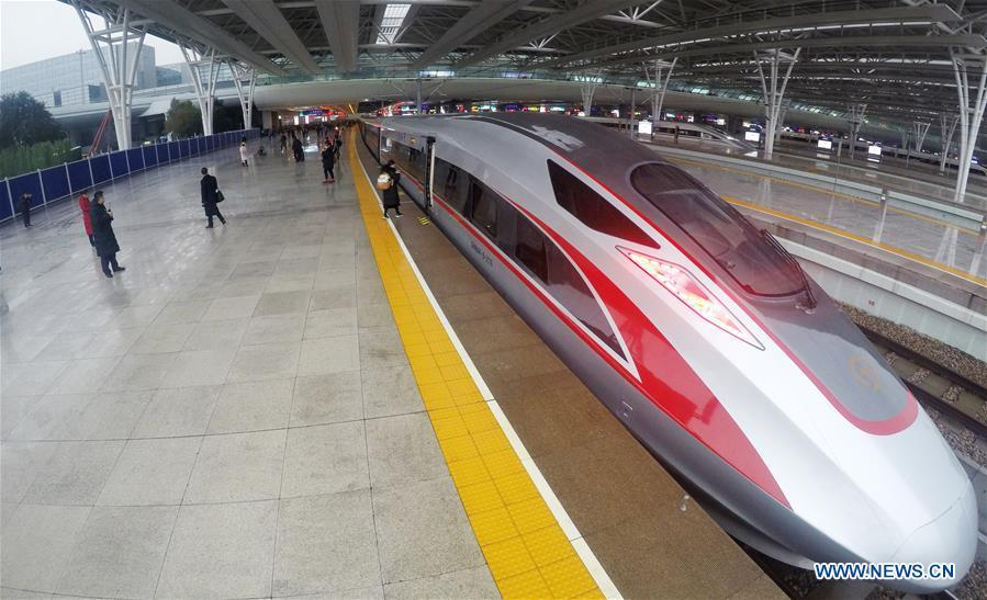 Photo taken on Jan. 5, 2019 shows a new Fuxing bullet train at Shanghai Hongqiao Railway Station in Shanghai, east China. A longer Fuxing bullet train started running on the Beijing-Shanghai line Saturday at noon. The new train, with a designed speed of 350 km per hour, has 17 carriages, one carriage longer than the Fuxing trains currently in use. (Xinhua/Fang Zhe)