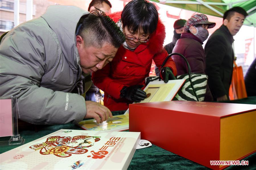 Citizens purchase special zodiac stamps for the lunar year of the Pig in Yinchuan, capital of Ningxia Hui Autonomous Region, Jan. 5, 2019. China Post on Saturday issued a set of special zodiac stamps in honor of 2019 Chinese Lunar New Year, or the Year of the Pig. The Year of the Pig starts from Feb. 5, 2019. (Xinhua/Feng Kaihua)