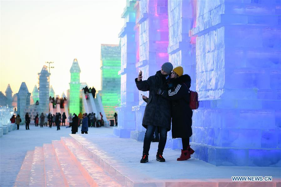 Tourists take selfies at the Ice-Snow World in Harbin, capital of northeast China\'s Heilongjiang Province, Jan. 5, 2019. The 35th Harbin International Ice and Snow Festival kicked off here on Saturday. (Xinhua/Wang Song)
