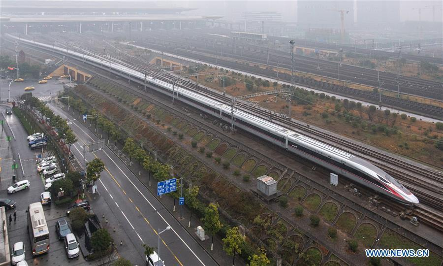Photo taken on Jan. 5, 2019 shows a new Fuxing bullet train running on the Beijing-Shanghai line arriving at Nanjing South Railway Station in Nanjing, east China\'s Jiangsu Province. A longer Fuxing bullet train started running on the Beijing-Shanghai line Saturday at noon. The new train, with a designed speed of 350 km per hour, has 17 carriages, one carriage longer than the Fuxing trains currently in use. (Xinhua/Su Yang) A longer Fuxing bullet train started running on the Beijing-Shanghai line Saturday at noon. The new train, with a designed speed of 350 km per hour, has 17 carriages, one carriage longer than the Fuxing trains currently in use. Measuring 439.9 meters long and with a seating capacity of 1,283 people, the 17-carriage train can be used with existing stations, platforms and other high-speed railway facilities. The Fuxing bullet trains first made its debut in June 2017, and the 16-carriage trains were put into operation in July 2018. Entirely designed and manufactured in China, the Fuxing, or Rejuvenation, trains are more spacious and energy-efficient, with a longer service life and better reliability than previous models.