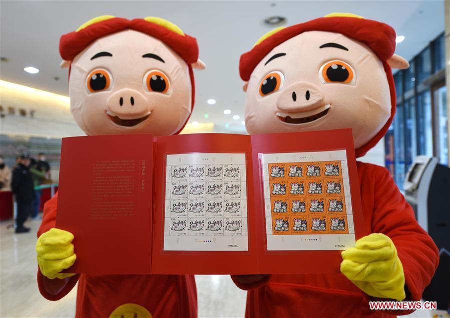Special zodiac stamps for the lunar year of the Pig are displayed in Nanjing, capital of east China\'s Jiangsu Province, Jan. 5, 2019. China Post on Saturday issued a set of special zodiac stamps in honor of 2019 Chinese Lunar New Year, or the Year of the Pig. The Year of the Pig starts from Feb. 5, 2019. (Xinhua/Sun Can)