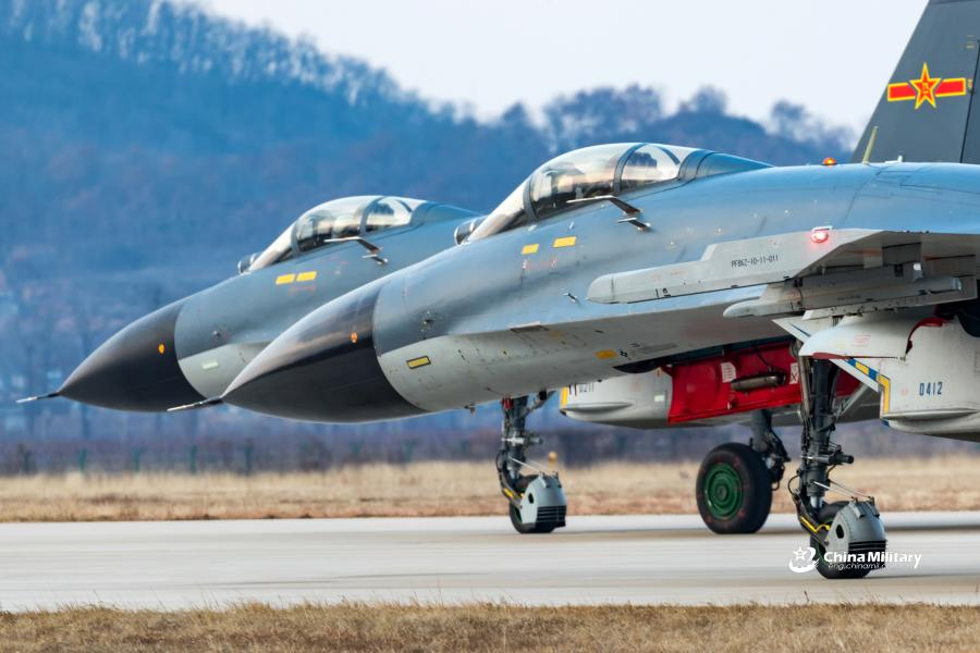 J-11B fighter jets attached to an aviation brigade of the air force with the PLA Northern Theater Command taxi on the runway during a round-the-clock flight training exercise on January 3, 2019. (Photo/eng.chinamil.com.cn)
