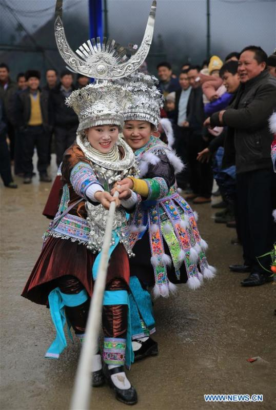 Girls of Miao ethnic group take part in a tug of war in Rongshui, Liuzhou City of south China\'s Guangxi Zhuang Autonomous Region, Jan. 5, 2019. Local Miao people celebrated their traditional New Year in various ways. (Xinhua/Long Tao)