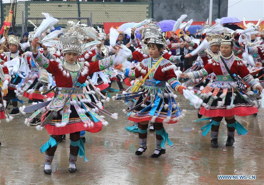 Girls of Miao ethnic group dance in Rongshui, Liuzhou City of south China\'s Guangxi Zhuang Autonomous Region, Jan. 5, 2019. Local Miao people celebrated their traditional New Year in various ways. (Xinhua/Long Tao)