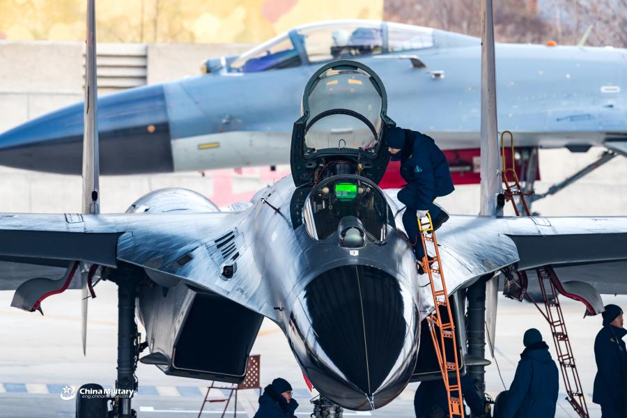 Maintenance men assigned to an aviation brigade of the air force with the PLA Northern Theater Command perform pre-flight inspections on a J-11B fighter jet prior to a round-the-clock flight training exercise on January 3, 2019. (Photo/eng.chinamil.com.cn)