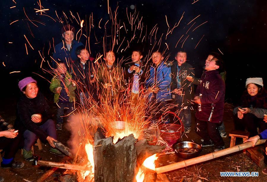 Villagers get together outdoor in Rongshui, Liuzhou City of south China\'s Guangxi Zhuang Autonomous Region, Jan. 5, 2019. Local Miao people celebrated their traditional New Year in various ways. (Xinhua/Huang Xiaobang)