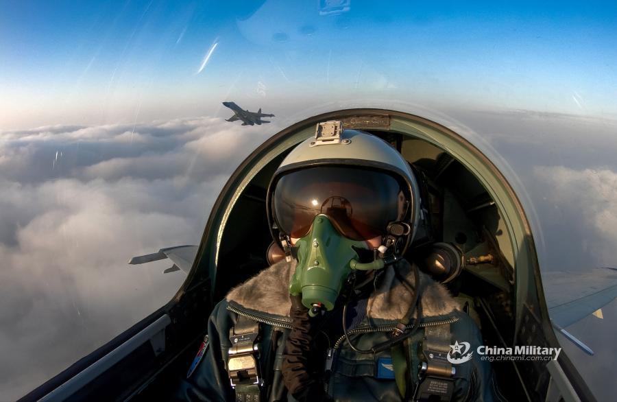 J-11B fighter jet flies past the sun