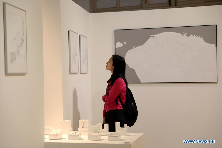 A visitor views exhibits during the \