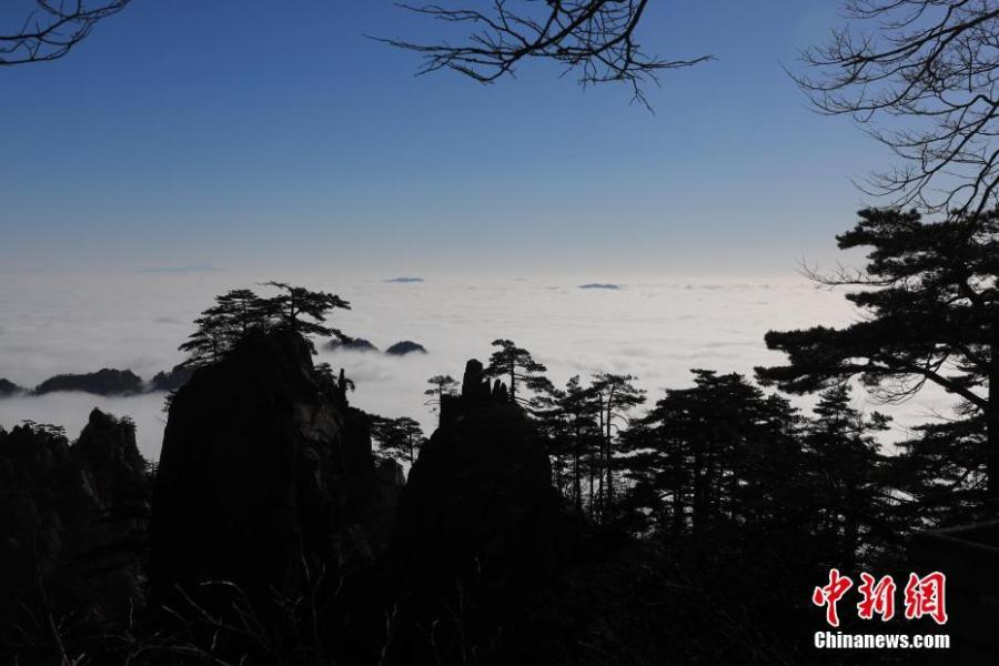 A sea of clouds after rain sweeps over Mount Huangshan in Anhui Province on Jan. 6, 2018. A UNESCO World Heritage site, the area is well known for its scenery, sunsets, peculiarly-shaped granite peaks, and pine trees. (Photo: China News Service/Shi Guangde)