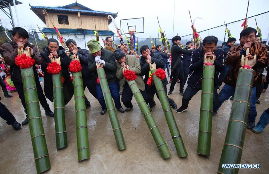 People of Miao ethnic group play Lusheng in Rongshui, Liuzhou City of south China\'s Guangxi Zhuang Autonomous Region, Jan. 5, 2019. Local Miao people celebrated their traditional New Year in various ways. (Xinhua/Long Linzhi)
